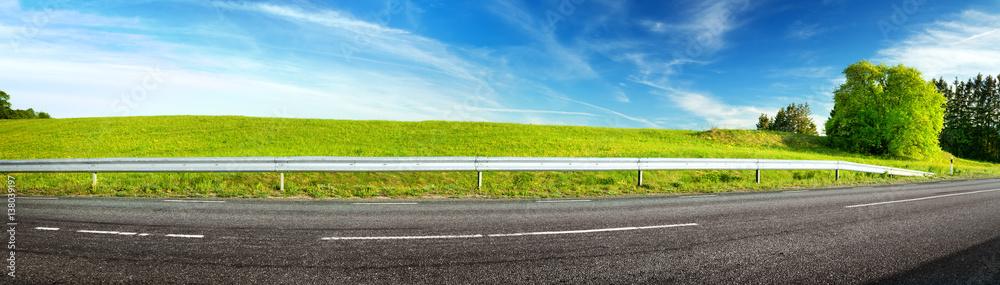 Fototapeta asphalt road panorama in countryside on sunny spring evening