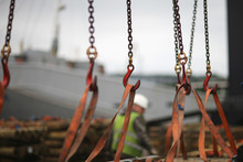 Chains And Hooks Hoist With Slings For Loading Timber In The Port