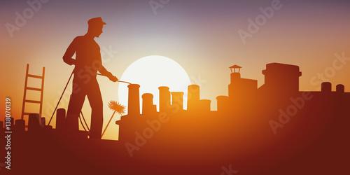 Fototapeta Métier du bâtiment avec un ramoneur sur un toit d'immeuble qui ramone une cheminée. Debout sur le toit, il travail sous une chaleur accablante. obraz