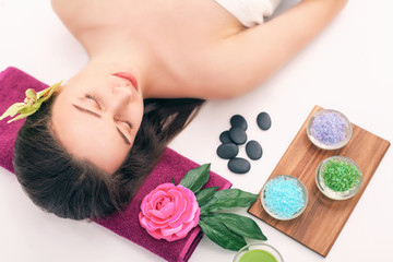 Obraz na płótnie Canvas people, beauty, spa, cosmetology and skincare concept - close up of beautiful young woman lying with closed eyes and cosmetologist applying facial mask by brush in spa