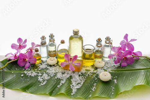 Fotobehang Spa Spa set on banana leaf with branch orchid