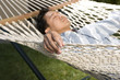 Asian Man Relaxing in a Hammock