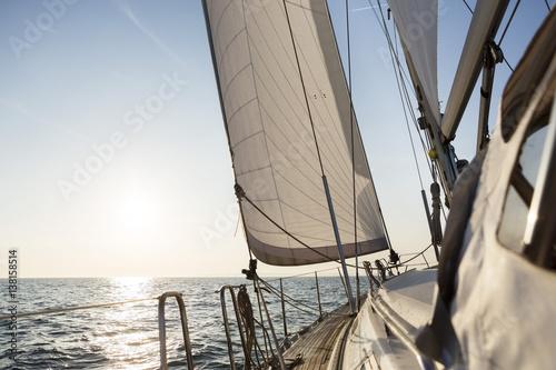 Staande foto Zeilen Luxury Sail Boat Sailing In Open Sea During Sunrise