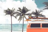 Vintage car parked on the tropical beach (seaside) with a surfboard on the roof - Leisure trip in the summer. retro color effect - 138167374