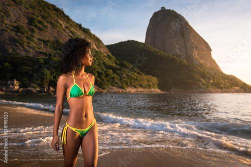 e4dfa6f02 ... in Rio de Janeiro. By dabldy. Young Beautiful Brazilian Woman in Bikini  Walking at the Beach by Sunrise With the Sugarloaf Mountain