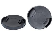 Black Camera Lens Cap On White Background.