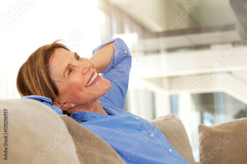 Deurstickers Ontspanning older woman smiling and relaxing at home