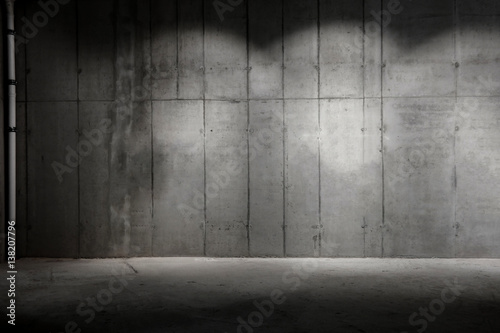 partially lit concrete wall construction site background