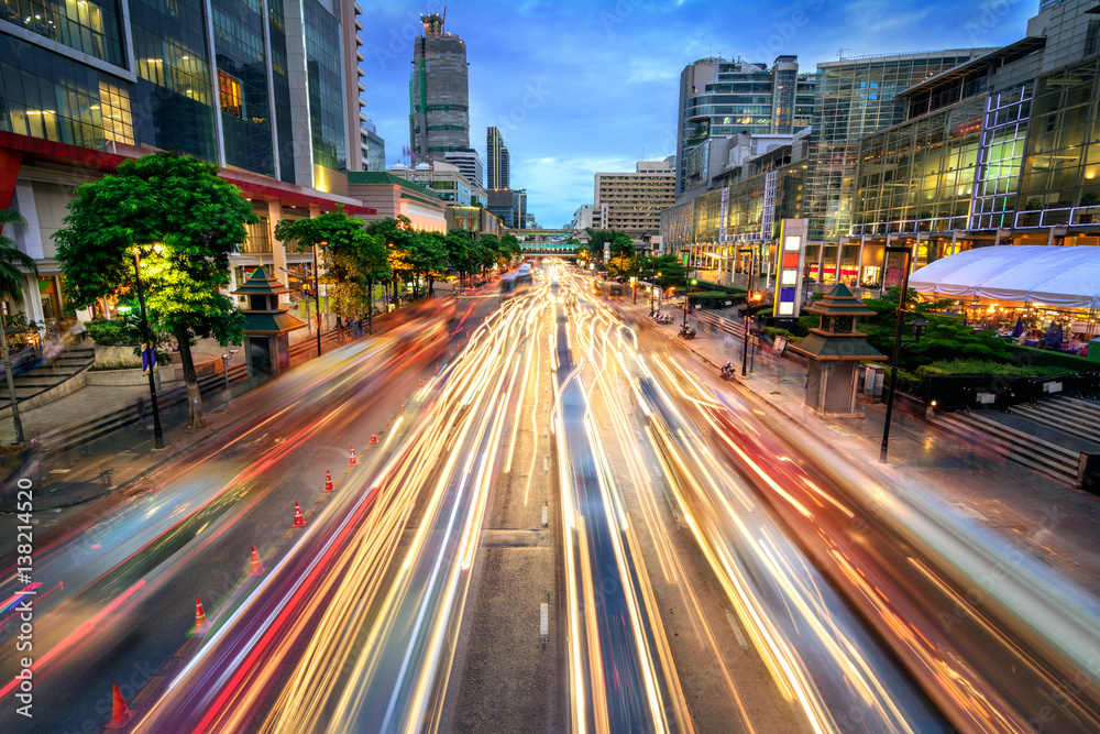 Fototapeta Busy street at dusk, full of car light streaks