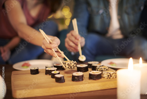 Poster Sushi bar Romantic date of couple eating seafood.