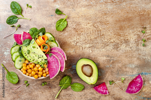 Poster Boeddha Vegan, detox Buddha bowl recipe with avocado, carrots, spinach, chickpeas and radishes. Top view, flat lay, copy space