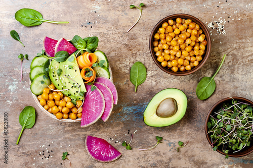 Tuinposter Boeddha Vegan, detox Buddha bowl recipe with avocado, carrots, spinach, chickpeas and radishes. Top view, flat lay, copy space