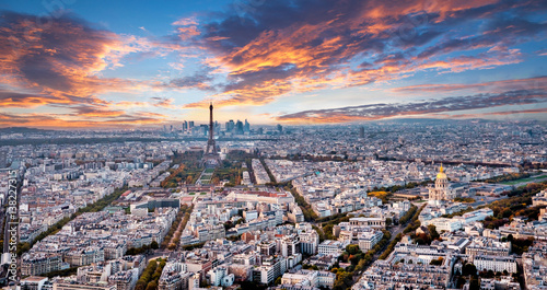 Poster de jardin Paris Aerial Paris panorama in late autumn from Montparnasse Tower at sunset. Eiffel Tower in the distance and financial district.