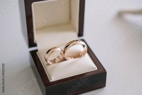 Beautiful Gold Wedding Rings Lying In Small Gift Box Buy This