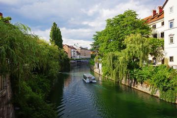 Fototapeta na wymiar The ljubljanica river and the Cankarjevo Nabrežje in Ljubljana