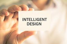 Businessman Holding INTELLIGENT DESIGN Message Card