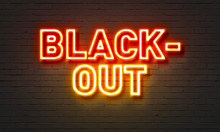 Blackout Neon Sign On Brick Wall Background.