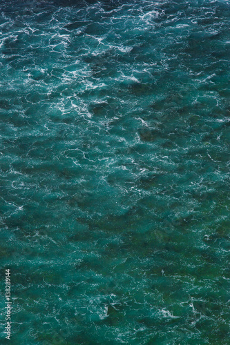 Fotobehang Zee / Oceaan Indian ocean texture. Turquoise sea water with white foam. Powerful and peaceful nature concept.