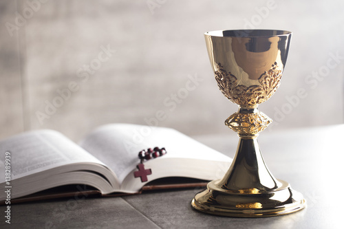 Fotografie, Obraz  Chalice, Bible and altar cross.