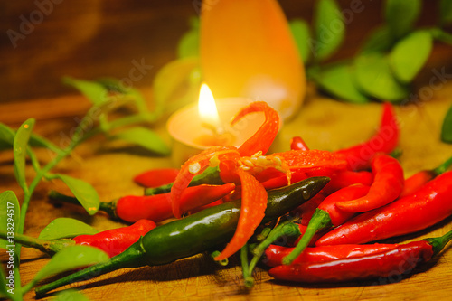 Staande foto Hot chili peppers Fresh red hot chili peppers on rustic wood background.