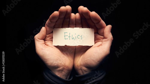 Hands holding a Business Ethics Concept