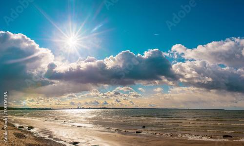 sea beach with blue sky and snow