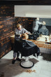 Little Boy Getting Haircut By Barber