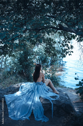 Fototapety, obrazy: Fashion Art Mystical Spring Model Girl Portrait in Moonlight Night. Sexy Glamour Summer Beautiful Woman with Healthy and Beauty Brown Hair with flowers over nature blurred background. Fairy