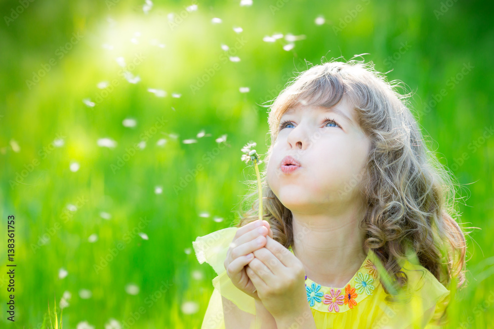 Fototapety, obrazy: Happy child blowing dandelion flower outdoors
