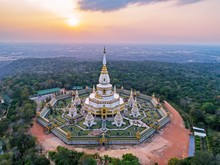 "Aerial View Landmark : "" Pra Maha Chedi Chai Mongkhol Temple "" At Sunset Sky. Beautiful Public Landmark Of Roi-Et Province, Thailand."