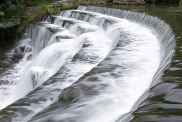 Fototapeta na wymiar Weir across the River Wye at Monsal Dale, Peak District, Derbyshire, UK