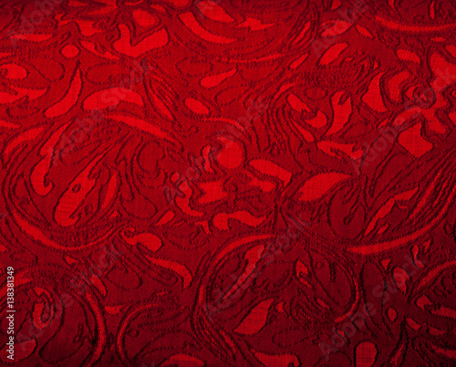 The texture of the silk fabric, red - 138381349