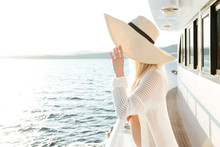 Attractive Beautiful Woman Wearing Hat Posing On The Yacht