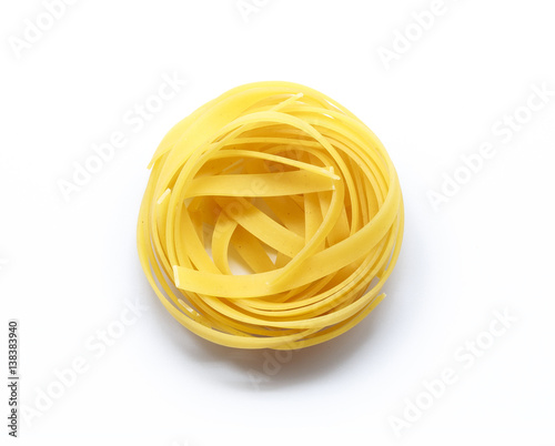 Fotografia  Fettuccine italian pasta isolated on white background