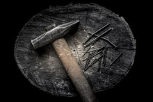 Hammer With Wooden Handle With Many Iron Hobnails On The Wooden Stub. Brutal Male Style