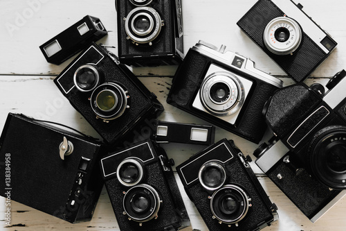 Stampe  vintage backgroun with collection old retro photo cameras