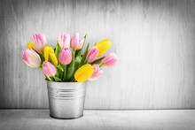 Fresh Bouquet Of Tulips In A Metal Pot On Rustic Wood.