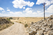 Santiago Cross On A Country Road On A Summer Day Between Hornillos Del Camino And Hontanas, Burgos, Spain