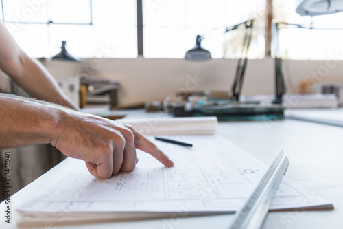 Fotografie, Obraz  Engineer designer architect hand close up of work desktop with ruler and other p