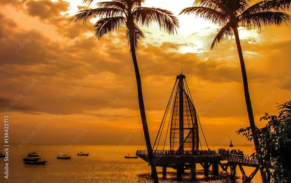 Fototapeta Los Muertos Pier during Puerto Vallarta sunset.