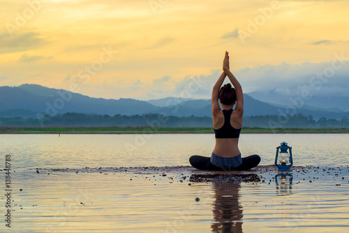 Fotobehang School de yoga young woman practicing yoga on the beach at sunset