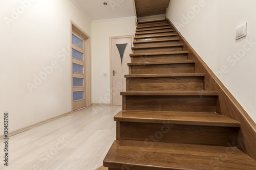 Photo Stands Stairs Modern architecture interior with elegant luxury hallway with glossy wooden staps stairs in modern storey house