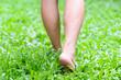 Leinwandbild Motiv Foot step on green grass