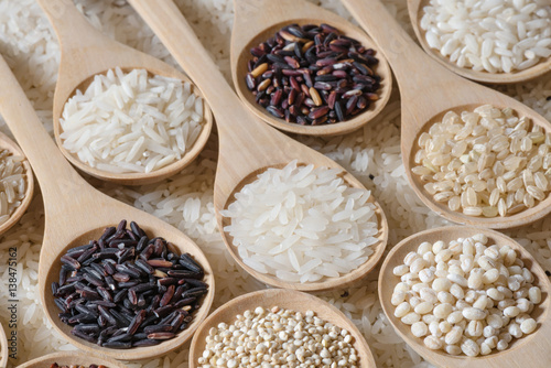 Fotografie, Obraz  Top view different rice on wooden spoon