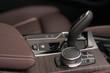 Automatic gear shift lever and infotainment system controls.