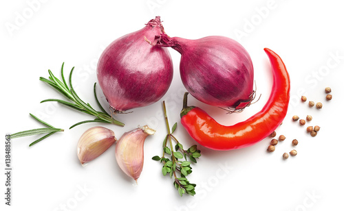 red onions and spices on white background