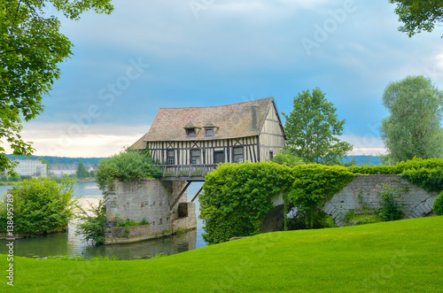 Old mill house on bridge, Seine river, Vernon, Normandy, France Canvas-taulu