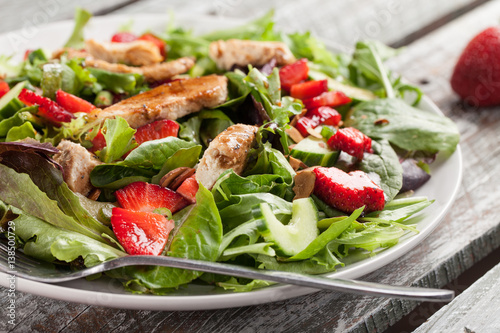 Strawberry Orange Honey Balsamic Salad on spring baby greens and spinach horizontal shot