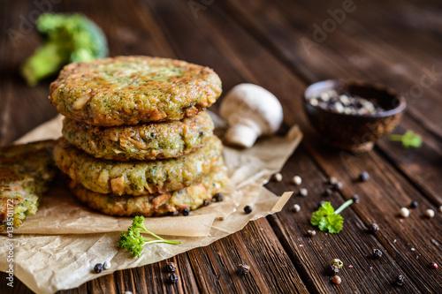 Fototapeta Fried vegetarian broccoli burgers with mushrooms and garlic obraz