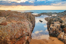 Beautiful Seascape With Sea And Rock In Nang Thong Beach, Khao Lak, Thailand. Tropical Colourful Sunset And View Of Dark Night Sea With Protruding Stones